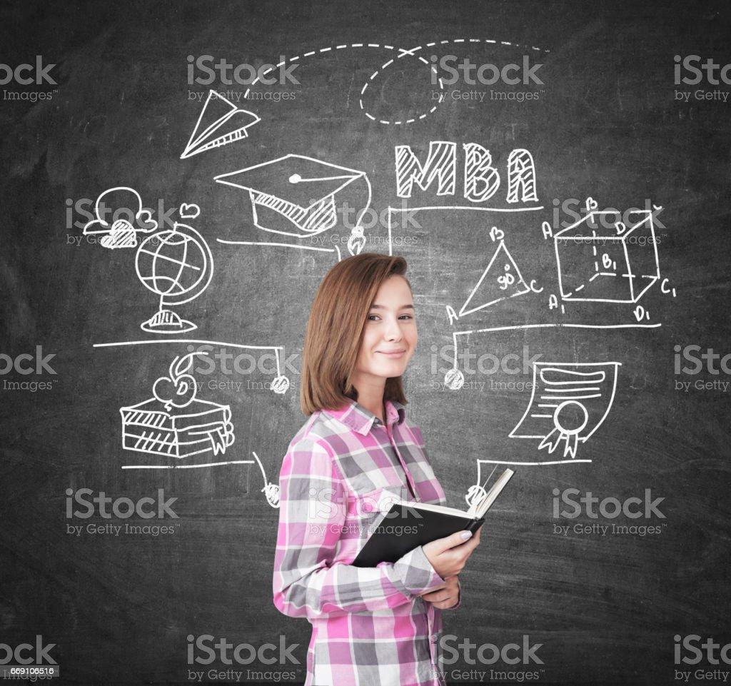 Geek girl and MBA sketch on chalkboard stock photo