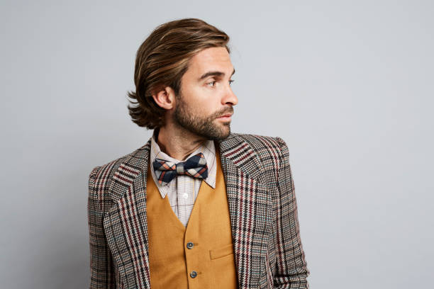 Geek guy looking away Geek guy in jacket and bow tie looking away bow tie stock pictures, royalty-free photos & images