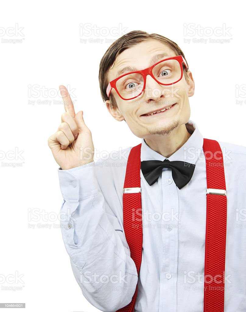Geek in red glasses and red braces grinning and pointing up royalty-free stock photo