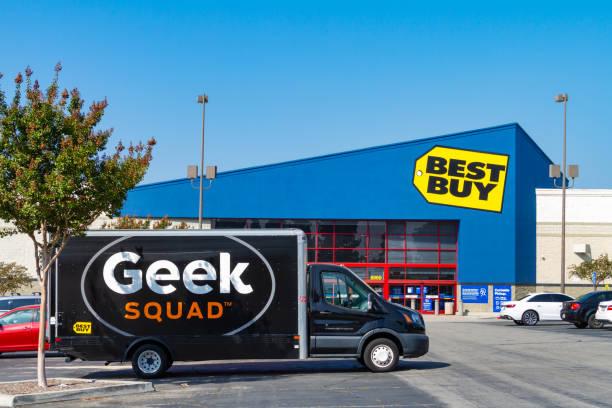 Geek Squad van parked at Best Buy stock photo