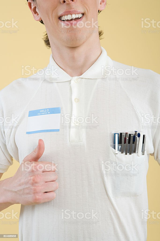 A geek with his thumbs up royalty-free stock photo
