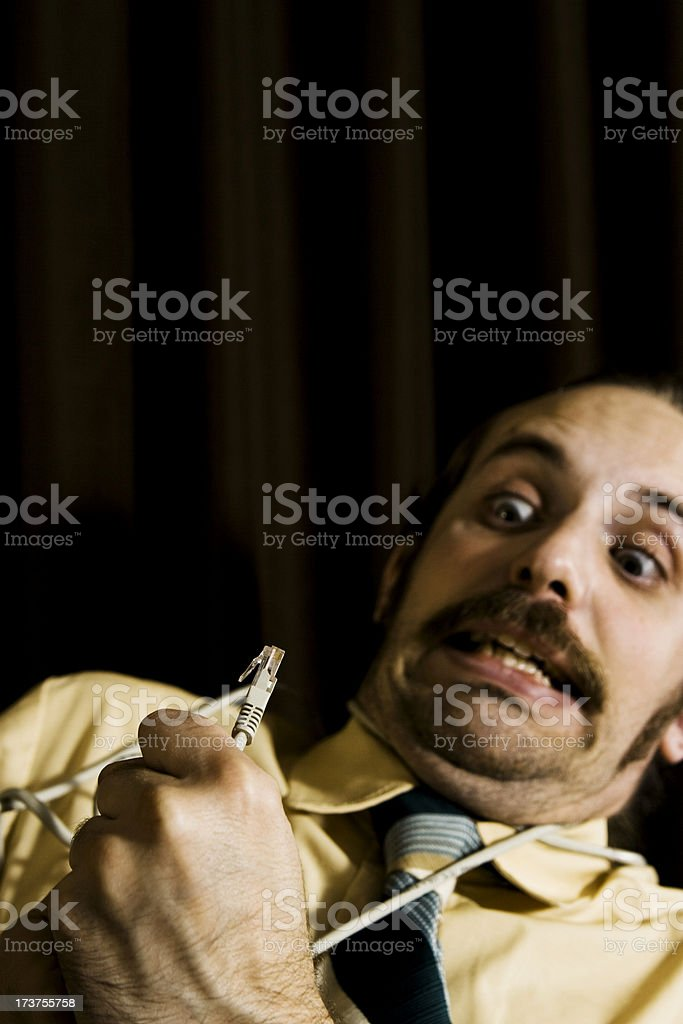Geeky colleague fighting with technology... royalty-free stock photo