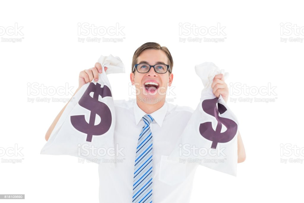 Geeky happy businessman holding bags of money stock photo