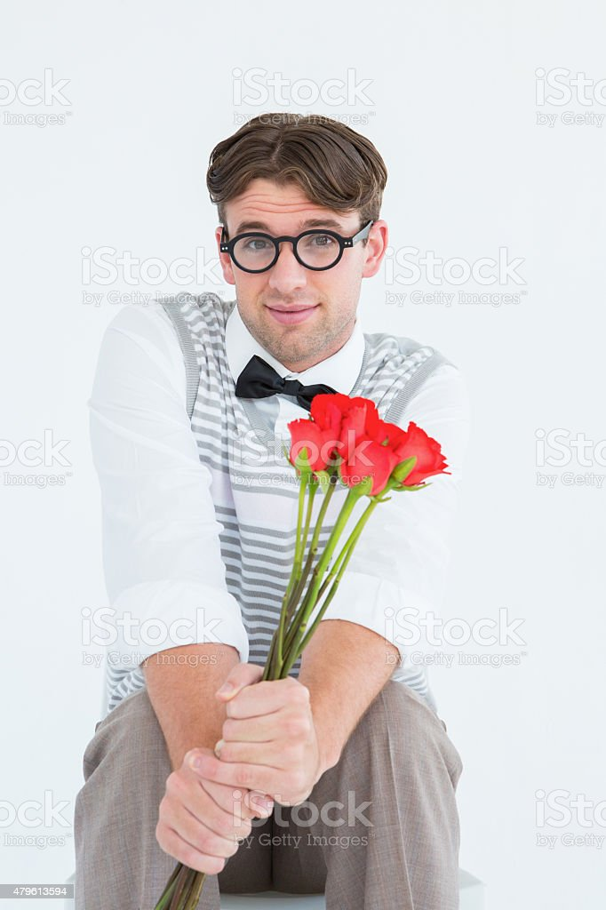 Geeky hipster offering bunch of roses stock photo