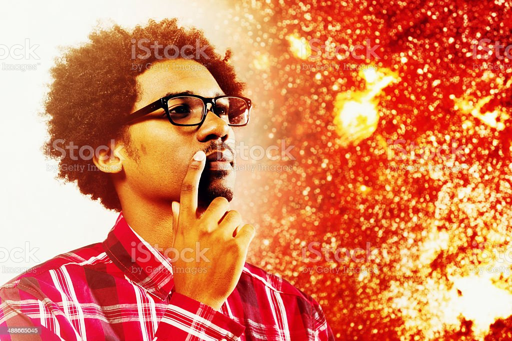 Geeky young scientist thinking about astronomy stock photo