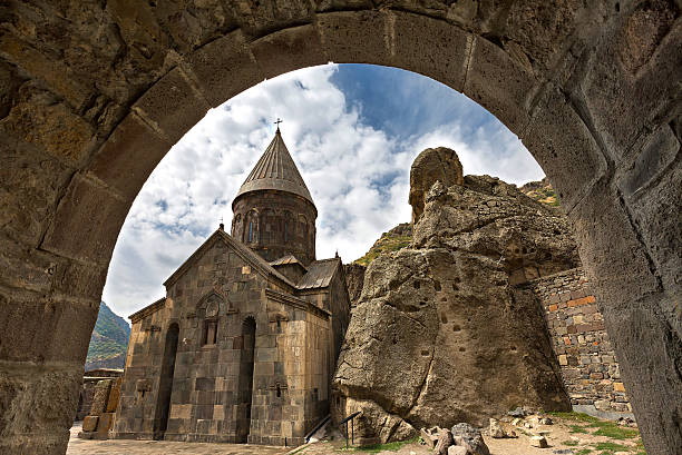 Geghard Monastery in Armenia Geghard Monastery through archway. monastery stock pictures, royalty-free photos & images