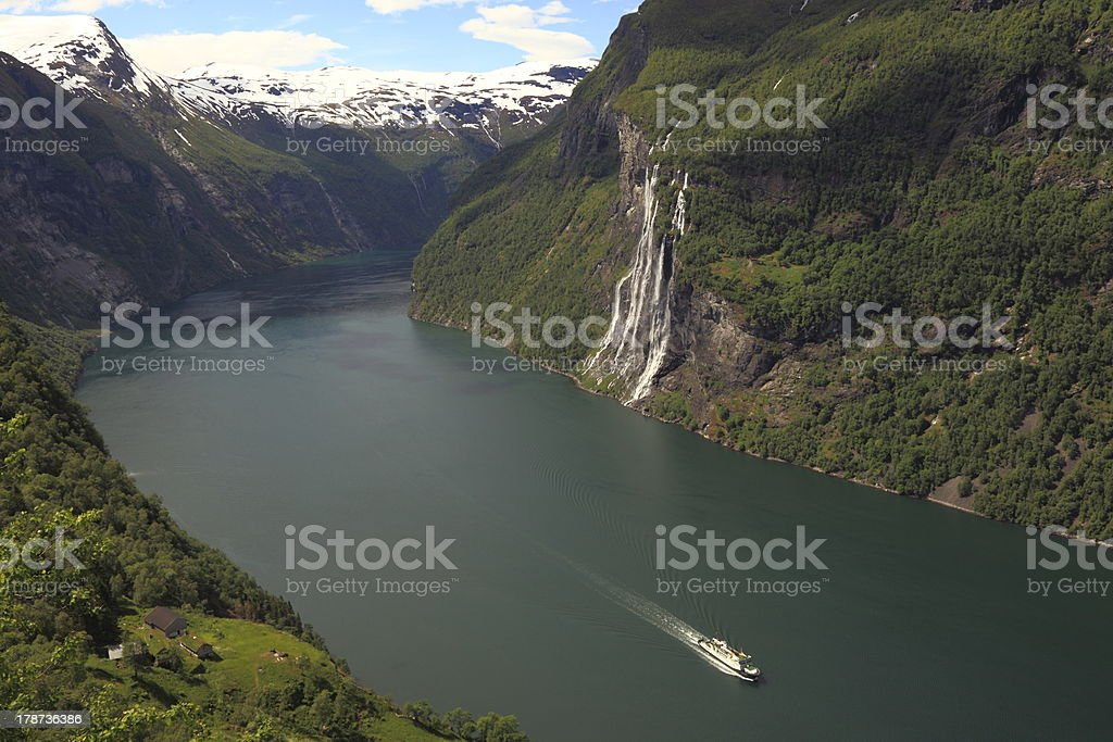Geiranger fjord and waterfall with boat cruise, Norway, Nordic stock photo