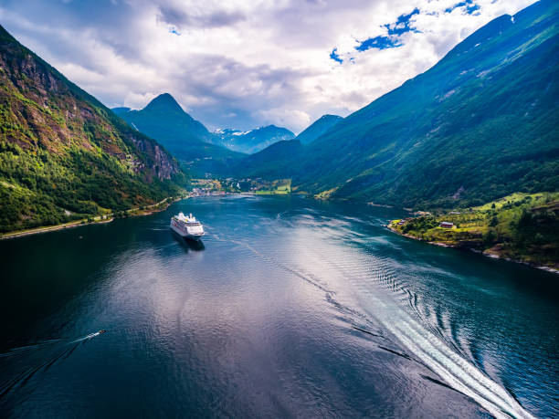 geiranger fjord, norway aerial photography. - fjord stock photos and pictures