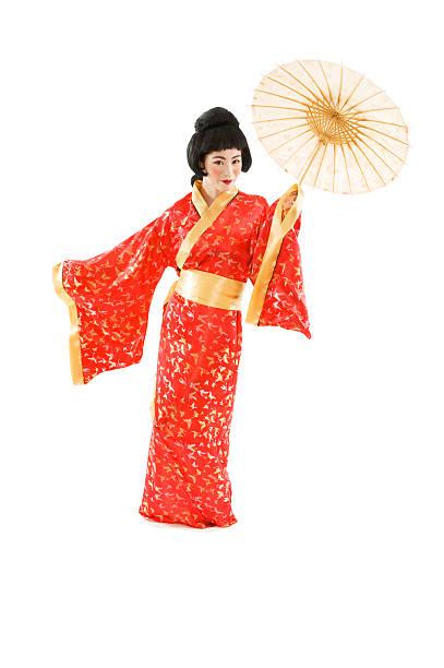 Geisha Holding A Parasol Stock Photo