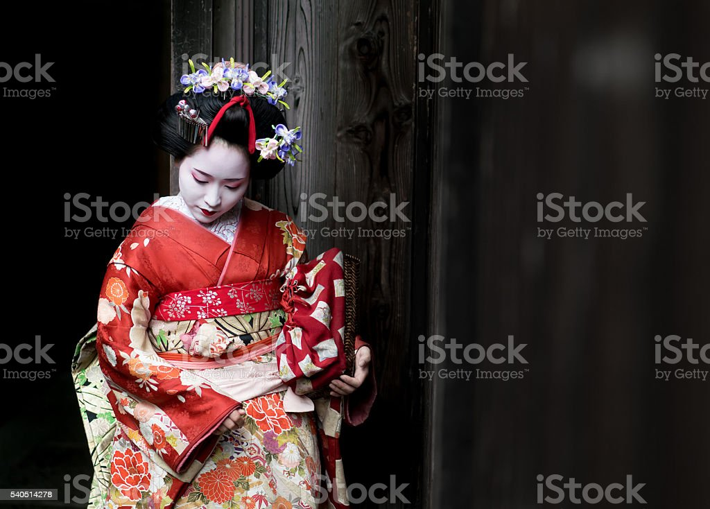 Geisha wearing a beautiful kimono stock photo