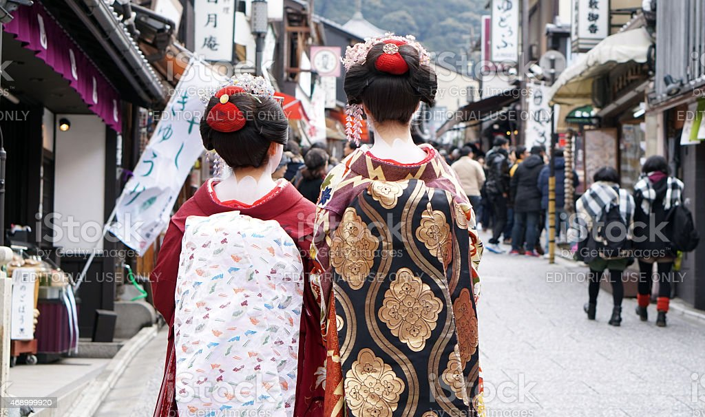 Geisha wears traditional clothes wit stock photo