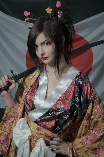 istock Geisha with katana 948693306
