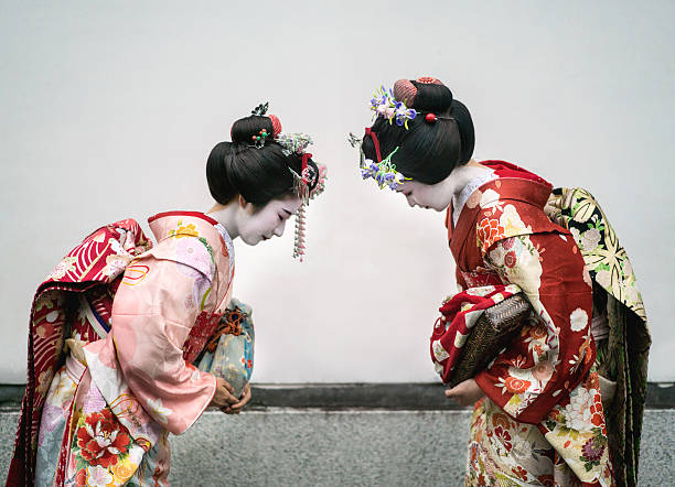 Geishas greeting each other Geishas greeting each other with a bow - Japanese culture concepts geisha stock pictures, royalty-free photos & images