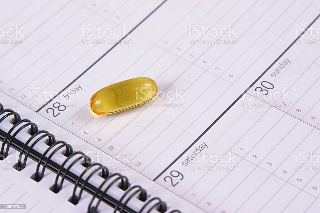 Gel Cap on Appointment Book royalty-free stock photo
