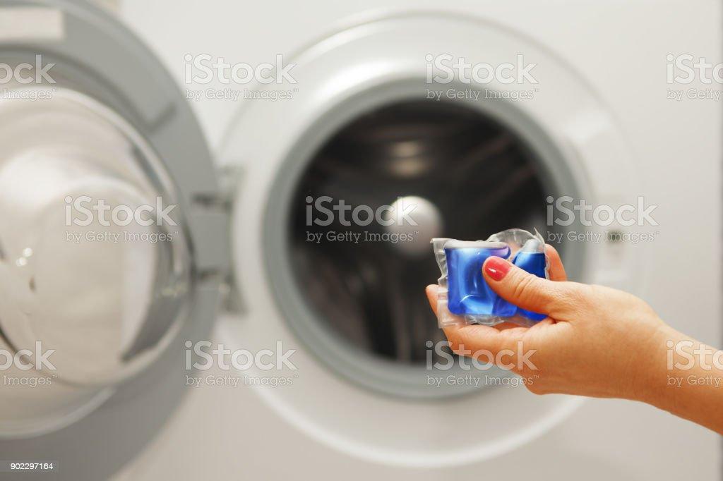 gel caps in hand stock photo