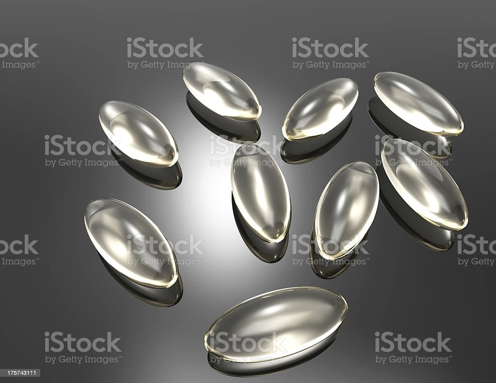 gel vitamin supplements on gray royalty-free stock photo