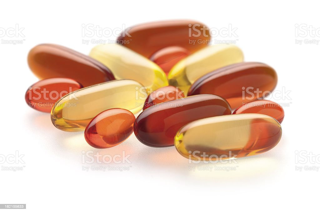 Gel vitamin supplements on white stock photo