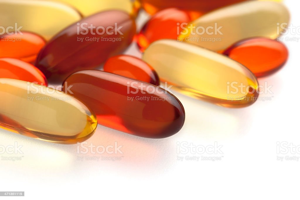 Gel vitamin supplements on white royalty-free stock photo