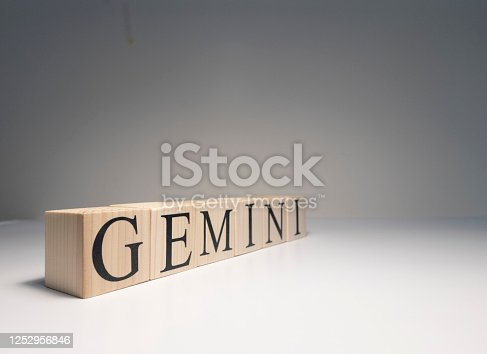 810006098 istock photo Gemini word on wooden cubes on white background. 1252956846