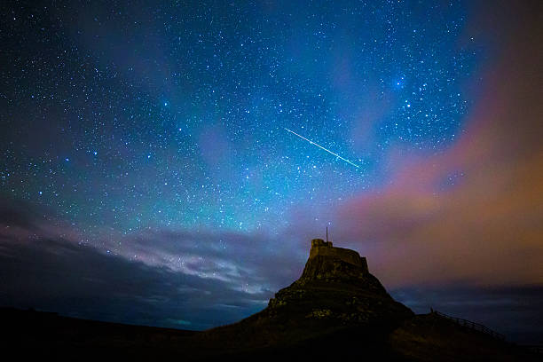 Geminid Meteor Geminid meteor over Lindisfarne Castle on the Holy Island, Nothumberland. big dipper constellation stock pictures, royalty-free photos & images