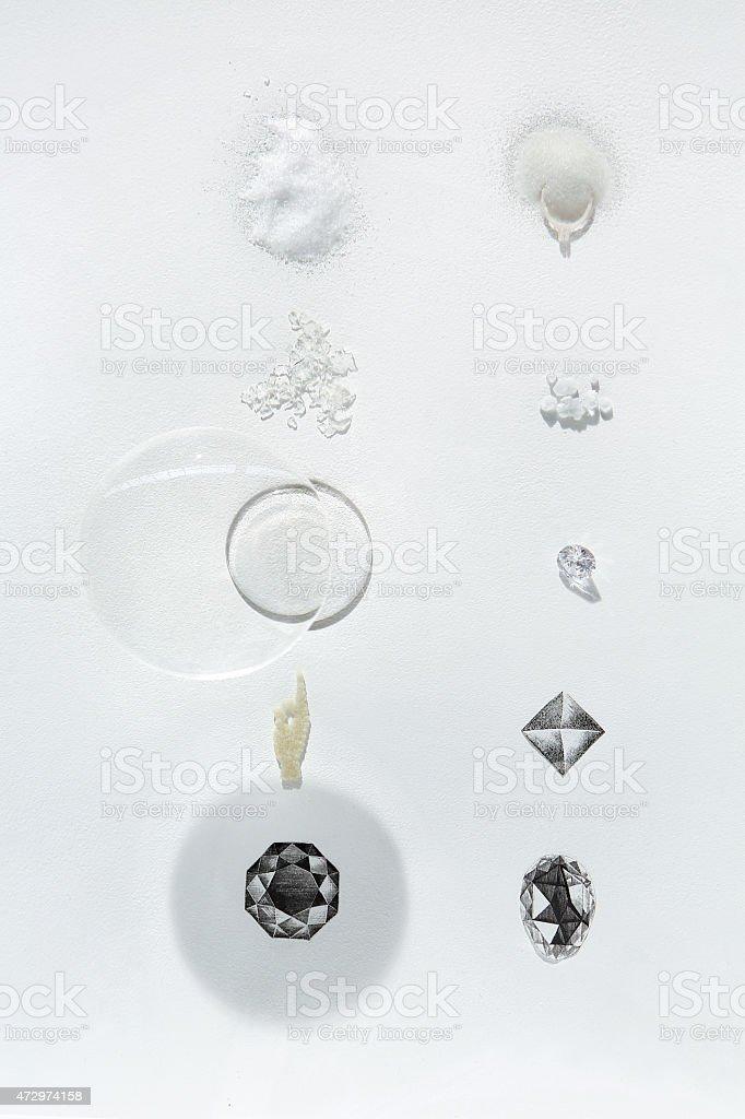 Gemological samples of glass, salt, carbon, graphite and diamond stock photo