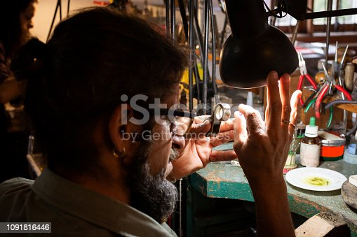 Man grinding a jewelry