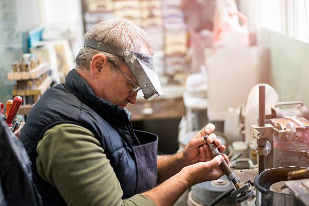 gemstone grinding - hand constructing industry stockfoto's en -beelden