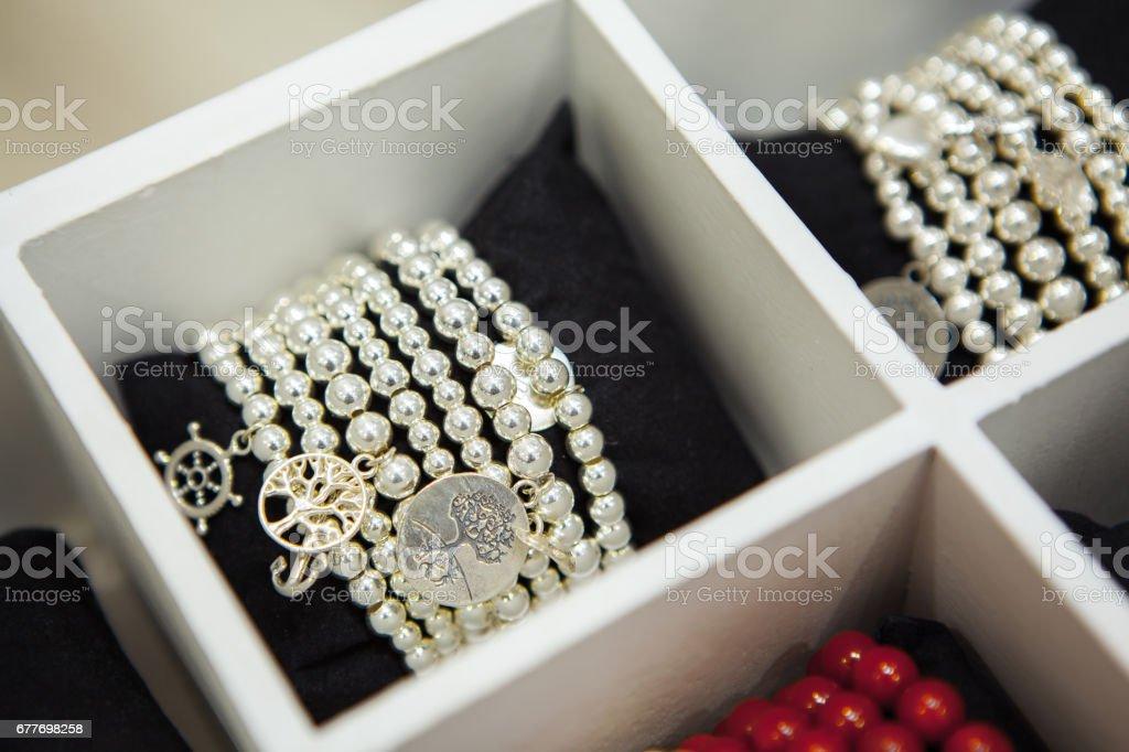 Gemstones handmade Bracelets on Shop-window. Fashion accessories stock photo