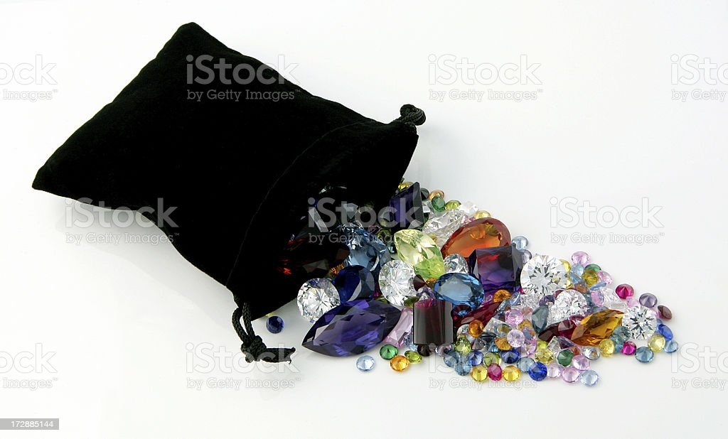 Gemstones spilling out of Black Velvet Bag royalty-free stock photo