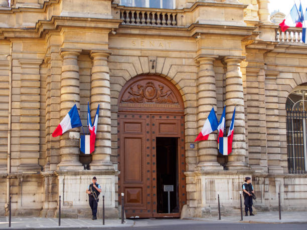 Gendarmerie police officers guard entrance to French Senate, Paris, France stock photo