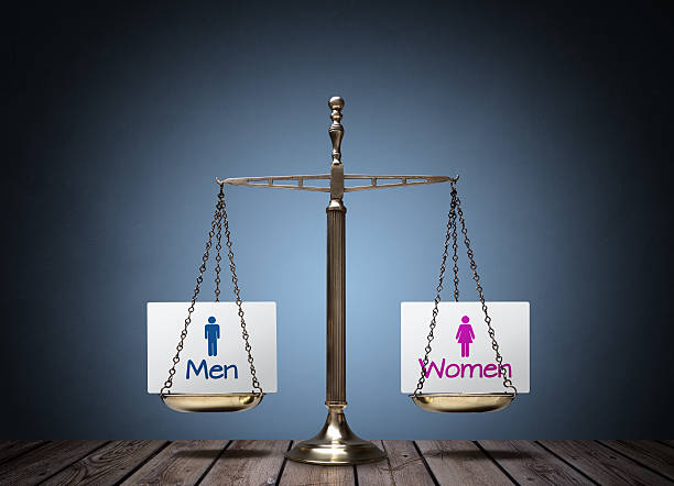 Gender equality Equality between man and woman concept with beam scales and sign women's rights stock pictures, royalty-free photos & images