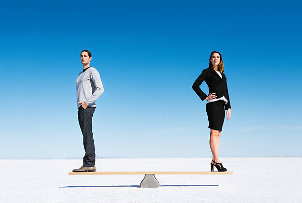gender equality - wages stock photos and pictures
