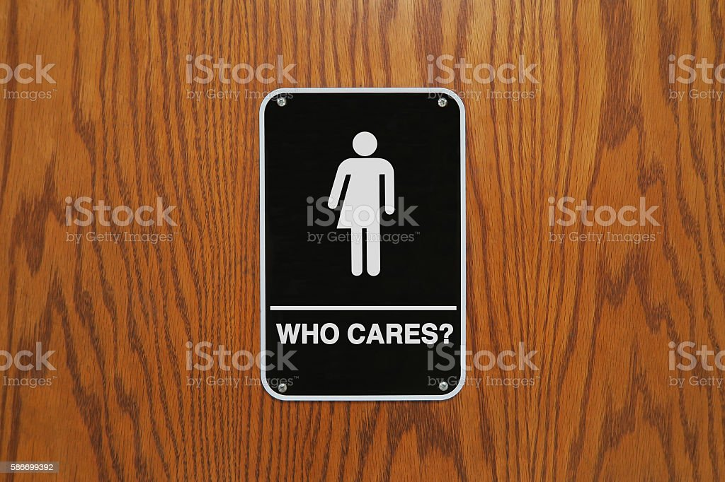 Gender neutral restroom sign that says, 'Who cares?' stock photo