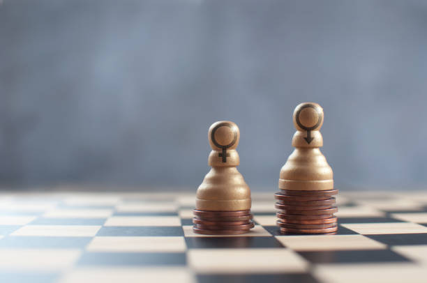 Gender pay chess concept stock photo