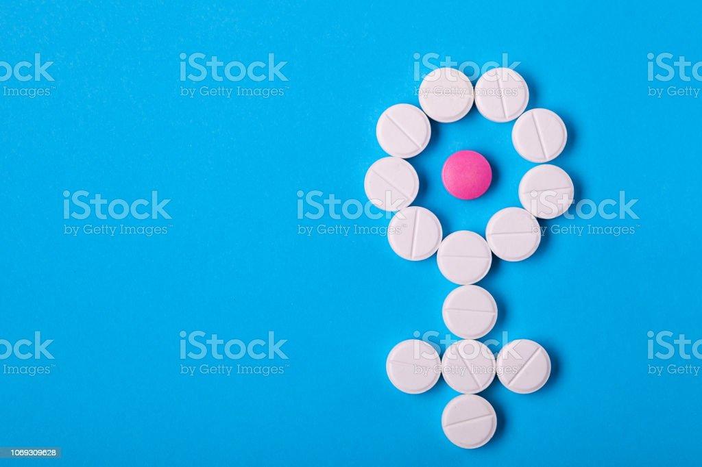 Símbolo de género de la mujer de las píldoras. - foto de stock