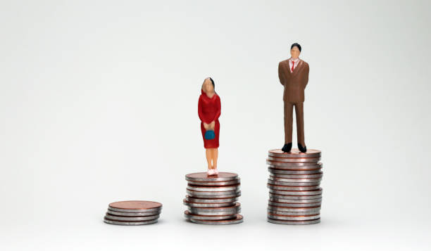 Gender wage difference concept. Three piles of different heights coins and miniature people. Gender wage difference concept. Three piles of different heights coins and miniature people. sex discrimination stock pictures, royalty-free photos & images