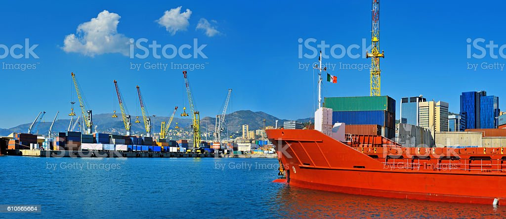 General cargo ship in the port waiting for containers in stock photo