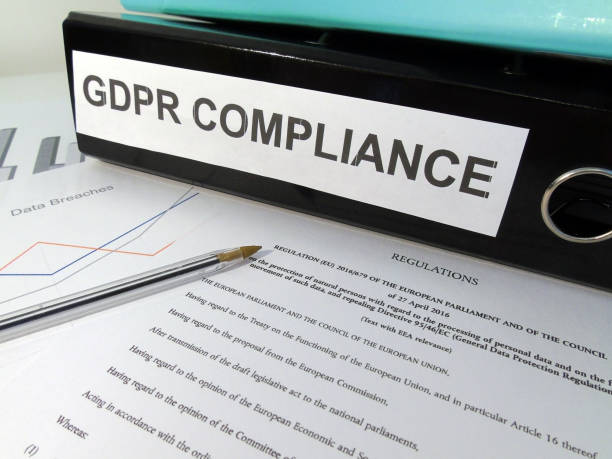 General Data Protection Regulation (GDPR) Compliance Lever Arch Folder on Desk with Documents (Legislative Text and Graphs) and Pen stock photo