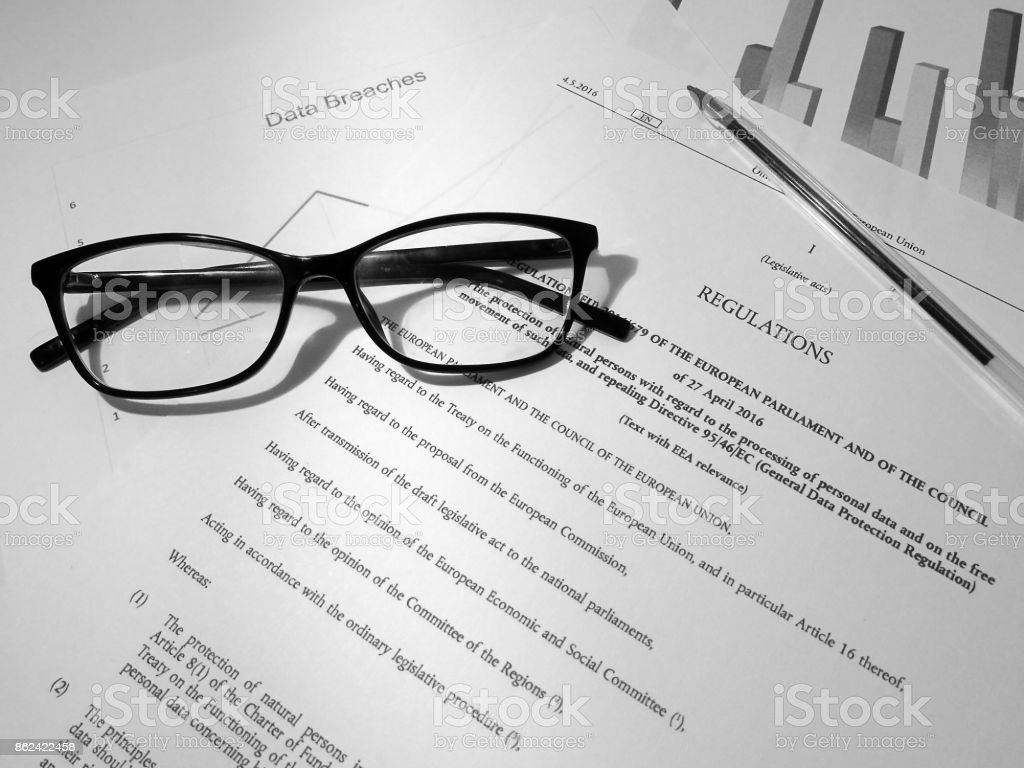 General Data Protection Regulation (GDPR) Documents on Desk (Including Graphs and Legislative Text) stock photo