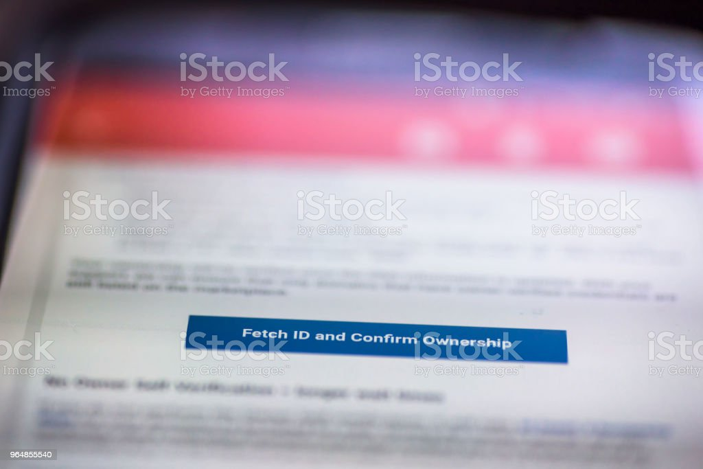 General Data Protection Regulation - GDPR - closeup smartphone message with button Fetch ID and Confirm Ownership royalty-free stock photo