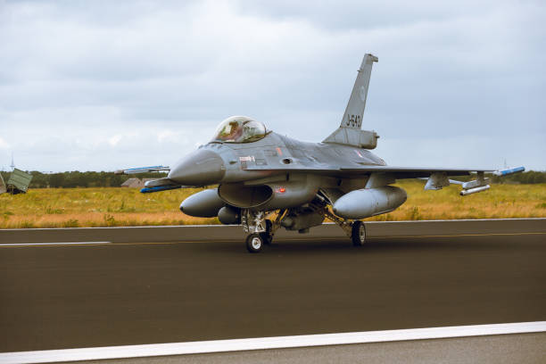 General Dynamics F-16A Fighting Falcon  at NTM2014 Schleswig - Jagel, Germany - June 19, 2014: Netherlands - Air Force General Dynamics F-16A Fighting Falcon J-643 is taxiing on strip of airbase Schleswig - Jagel during NATO Tiger Meet 2014. f 16 fighting falcon stock pictures, royalty-free photos & images