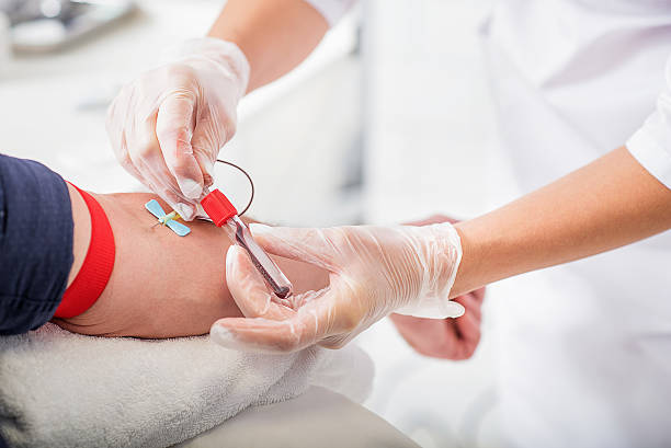 General practitioner doing blood test stock photo