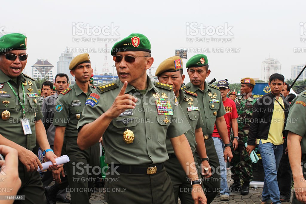 General Pramono Edhie Wibowo Jakarta, Indonesia-October 06, 2012: Chief of staff of the army, General Pramono Edhi Wibowo is reviewing military army weapons exhibition in the national monument. Adult Stock Photo