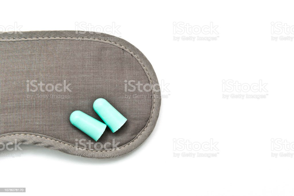 General solution for sleep disorder, eye shade, ear plugs and sleeping pills stock photo