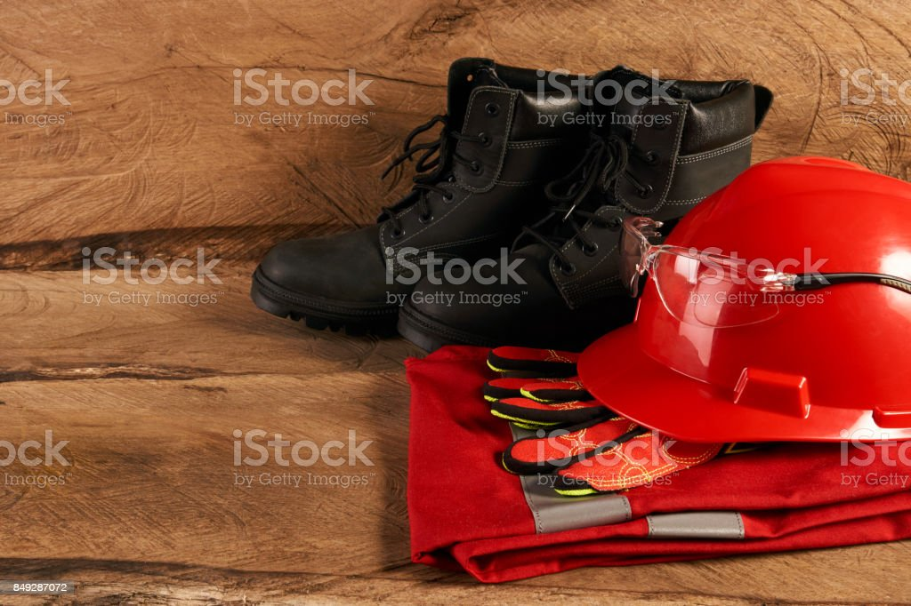 Set of black safety waterproof shoes leather gloves hard hat or...
