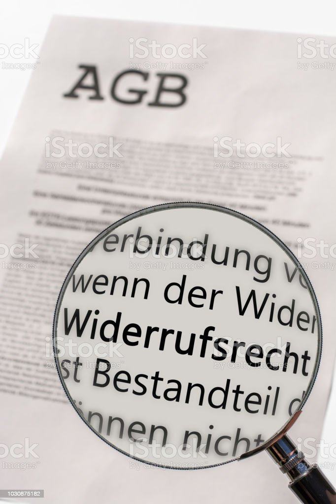General terms and conditions are examined with the magnifying glass with the German word for revocation stock photo