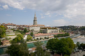 Bern, Switzerland - September 11, 2015: General view of Bern and the steeple of the cathedral towering over the city. The Capital City of Switzerland it is the 4th most populous city in Switzerland. This is one of the countless wonderful places in Switzerland, which is a tourist attraction often visited by many tourists from all over the world.