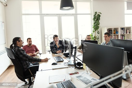 Shot of a group of colleagues using a computer together in an office.