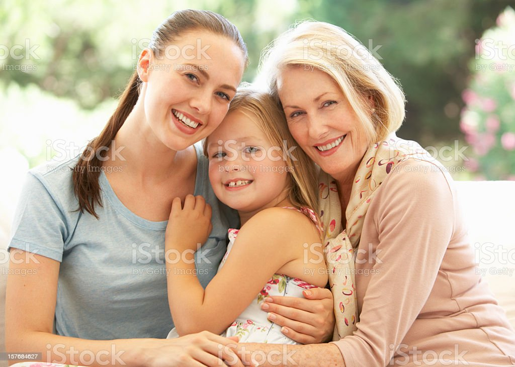 3 Generation Family Laughing Together On Sofa stock photo