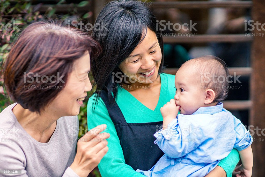 3 generation family outside cafe stock photo